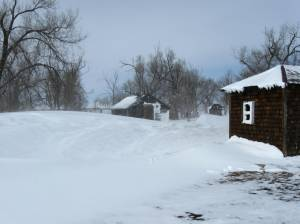 Chicken coop in the background almost completely obstructed by a drift.  The drift is covering the future garden area.